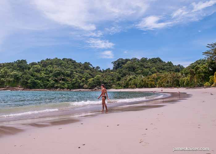Woman walking on Playa Manuel Antonio, Costa Rica
